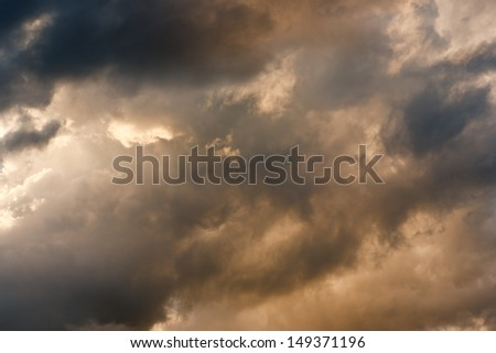 Stormy clouds with sunshine peeking through - stock photo