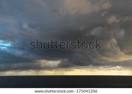 Stormy Dark Clouds over the Atlantic Ocean Water - stock photo