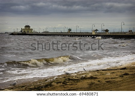 Stormy day at Melbourne's St Kilda beach and pier. - stock photo