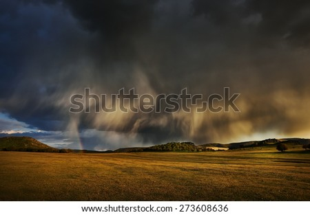 stormy day on field in spring - stock photo
