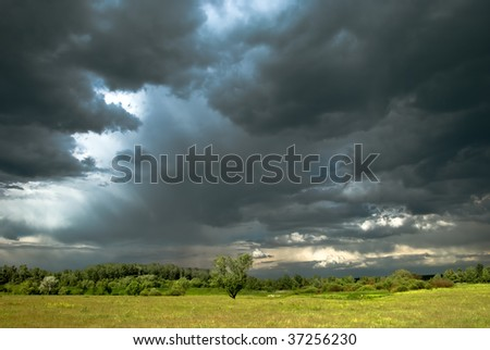 Stormy day with rain, fall colors and dark clouds