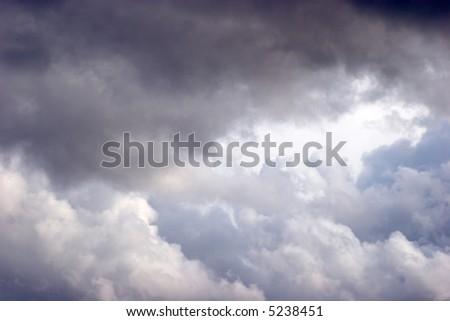 Stormy grey majestic cloudscape - stock photo