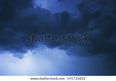Stormy Night Sky. Cloudy Stormy Clouds Illuminated by Lightnings. Severe Weather Photography Collection. - stock photo