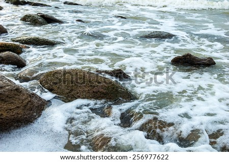 Stormy sea waves on the rocky shore. - stock photo