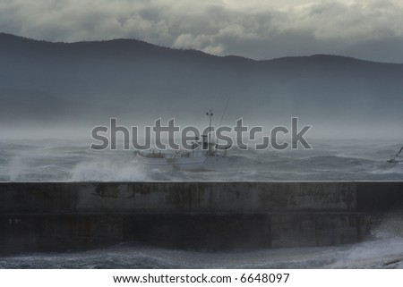 Stormy seas at Bicheno, off the coast of Tasmania, Australia. The worst storms in recorded history, apparently. I risked life and limb to take these shots!!! It was scary. - stock photo