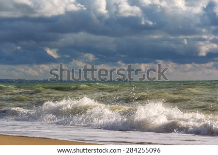 Stormy skies over the sea and the city of Sevastopol on the horizon. Crimean Black sea coast - stock photo