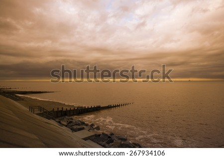 Stormy Skies over Withernsea, at sunset in East Cost Yorkshire, UK