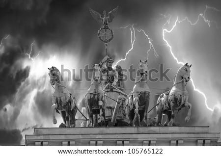 Stormy sky above Quadriga Monument in Brandenburg Gate, Berlin - stock photo