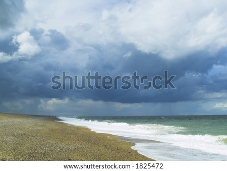 Stormy sky at Cley beach, North Norfolk UK - stock photo