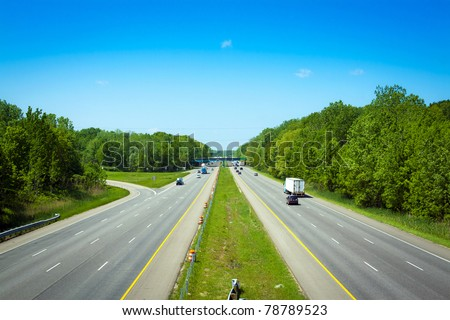 Stormy Sky on american toll way - stock photo