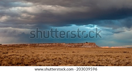 Stormy sky over a mesa in Petrified Forest National Park, Arizona. - stock photo
