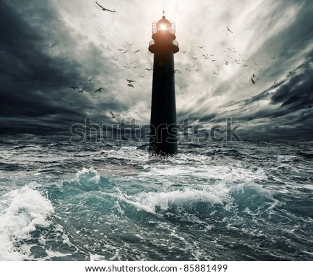 Stormy sky over flooded lighthouse - stock photo