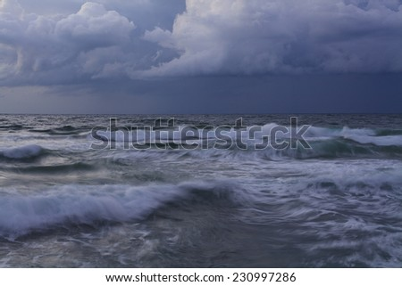 Stormy sky over the wave of the sea.  - stock photo