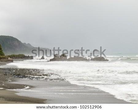 Stormy surf of Tasman Sea pounding West Coast of South Island of New Zealand - stock photo