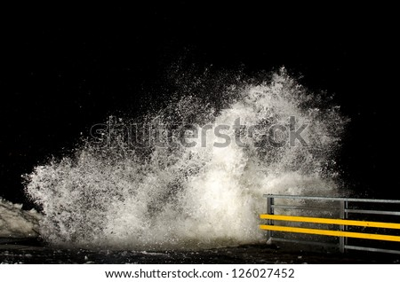 Stormy weather and breaking waves at night - stock photo