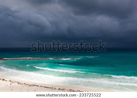 Stormy weather in Cancun, beautiful turquoise sea under dark blue clouds, view from above - stock photo