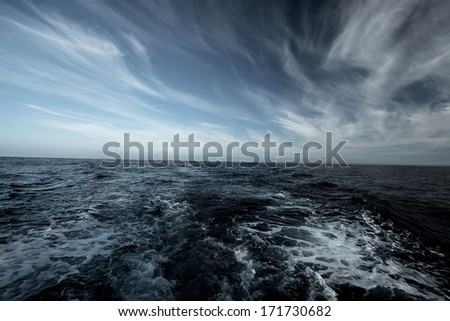 Stormy weather in ocean - stock photo