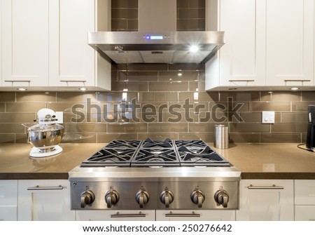 Stove closeup in modern kitchen interior with stainless steel gas cook-top. - stock photo