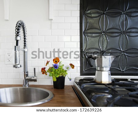 Stove top and sink in country kitchen - stock photo