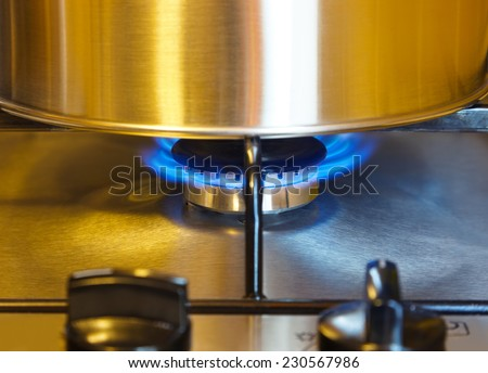 Stovetop saucepan - cooking kitchen background - stock photo