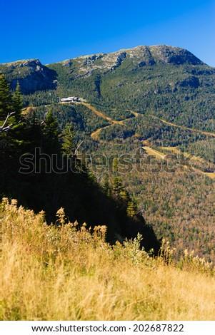 Stowe Mountain Resort ski trails during late fall foliage season, Stowe Vermont, USA - stock photo