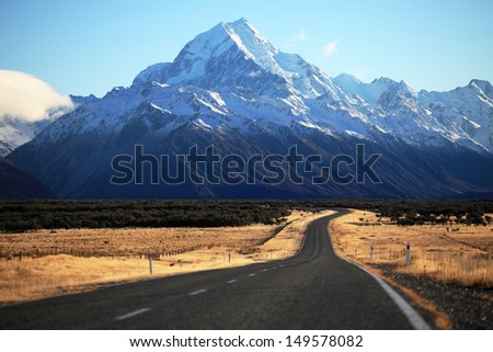 Straight empty road to Mount Cook National Park, New Zealand  - stock photo