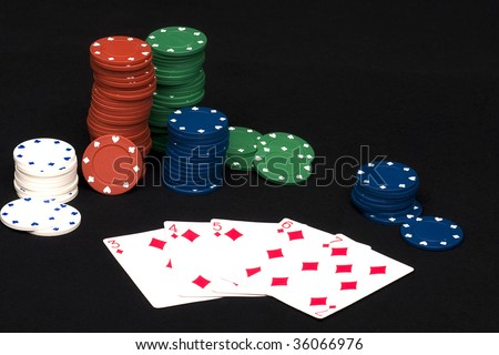 Straight Flush hand in playing poker with chips