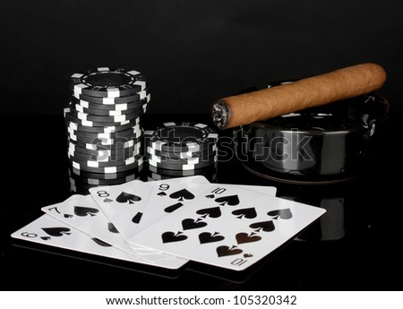 straight flush with poker chips on black background - stock photo