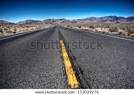straight highway death valley - stock photo