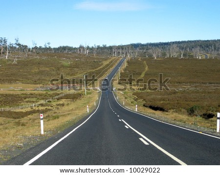 Straight Long Road In Tasmania National Park - stock photo