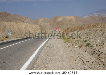 Straight mountain route in Iran. Summer day - Desert - stock photo
