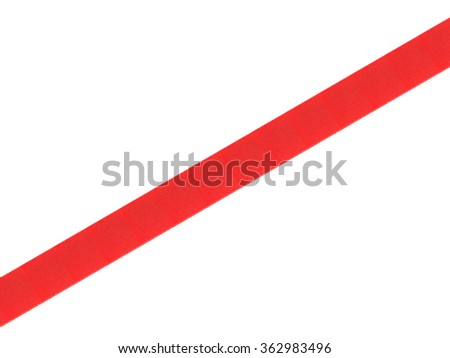 Straight red shiny ribbon, positioned diagonally from corner to corner. Photographed isolated on a white background. An attractive design element for web pages and brochures. - stock photo