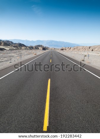 Straight road passing through landscape, Death Valley National Park, California, USA