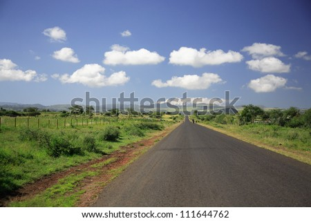 Straight Road to Mount Kenya Africa - stock photo