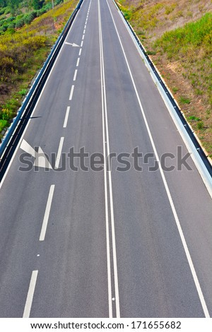 Straight Stretch of the Asphalt Road  in Portugal