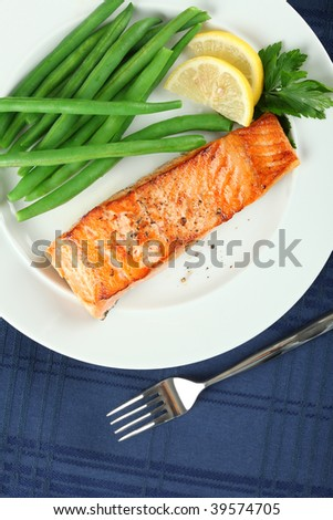Straight View of Grilled Salmon Fillet with Green Beans Plate