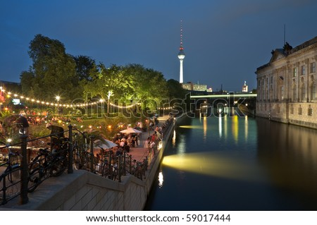 Strand Bar in Berlin at the river Spree beside the Bodemuseum at night. - stock photo
