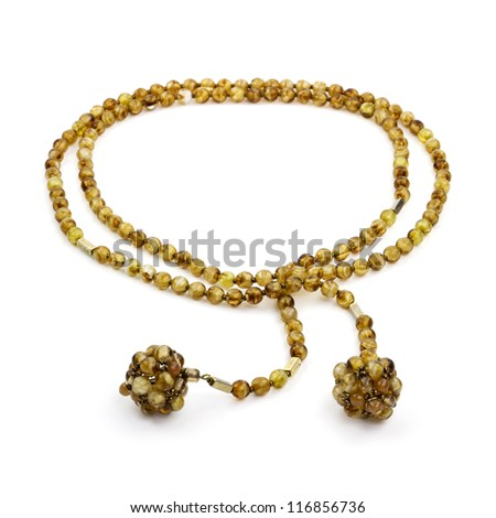 Strand necklace made of natural golden yellow beads isolated on white background.