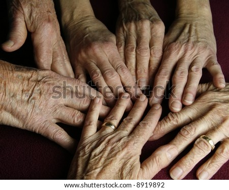 strange grouping of hands touching one another