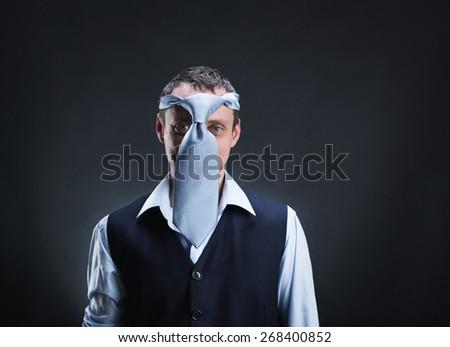 Strange man with necktie on his head - stock photo