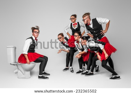 Strange people in red tutu with glasses - stock photo