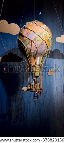 Strange steampunk balloon which flies between clouds and aims for the stars