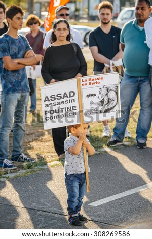 STRASBOURG, FRANCE - AUG 20, 2015: People protesting in front of European Parliament denouncing the Syrian airstrikes on Douma wheremore 80 were killed - Assad assassin, Putin complicit - stock photo