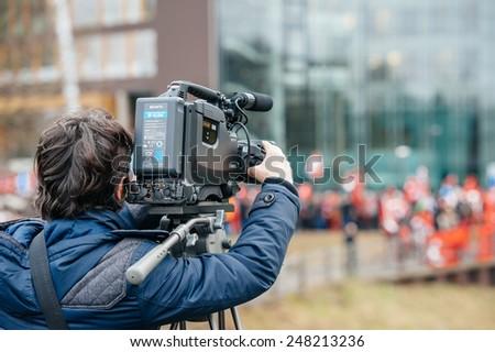 STRASBOURG, FRANCE - 28 JAN 2015 Cameraman filming Turkey diaspora near European Court of HR before the Perincek vs. Switzerland case begin. Armenian government was represented by Amal Clooney - stock photo