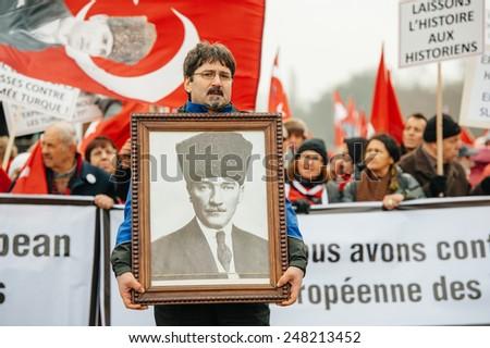 STRASBOURG, FRANCE - 28 JAN 2015 Man holding Ataturk portrait at demonstration near European Court of HR before the Perincek vs. Switzerland case begin. Armenian Gov was represented by Amal Clooney - stock photo