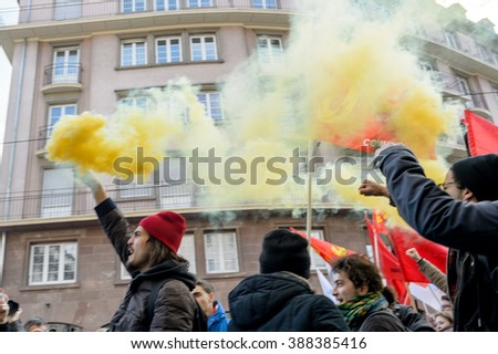 STRASBOURG, FRANCE - 9 MAR 2016: People burn flares and smokes grenade as thousands of people demonstrate as part of nationwide day of protest against proposed labor reforms by Socialist Government