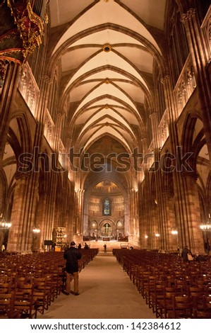 STRASBOURG, FRANCE - 19 MARCH, 2013: Interior of the famous cathedral of Strasbourg, France on 19 March, 2013. It is widely considered to be among the finest examples of late, Gothic architecture.