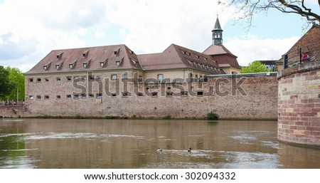STRASBOURG, FRANCE - MAY 9, 2015:  Old architecture by the river Ill in the Petite France district of Strasbourg, capital of the Alsace region in France. - stock photo