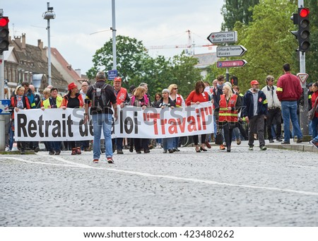 STRASBOURG, FRANCE - MAY 19, 2016: People marching on closed central streets in Strasbourg with retire labor reform placard during a demonstration against proposed French government's law reform - stock photo