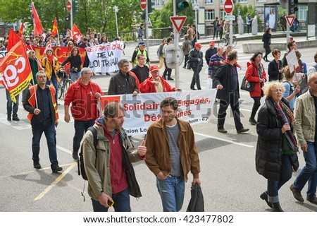 STRASBOURG, FRANCE - MAY 19, 2016: People with anti-laboor placards during a demonstrations against proposed French government's labor and employment law reform - stock photo